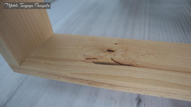 Wada drewna w dolnej ramie